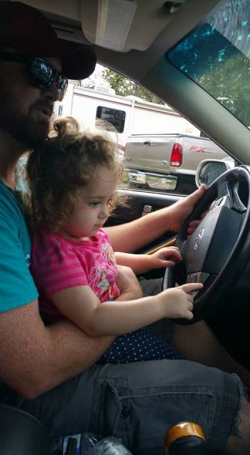 daddy-daughter-driving-on-closed-road